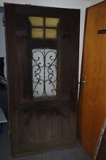 Alte Haustür mit Gitter