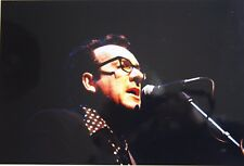 Photo of Elvis Costello in concert original mounted 11.9 x 8 in by Mel Longhurst