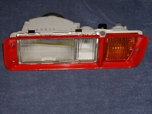 1987 Chrysler Conquest Left Driver Turn Signal / Fog Light Lamp Assembly & Trim