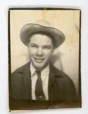 Smiling young guy in hat and tie. .  Vintage photo booth