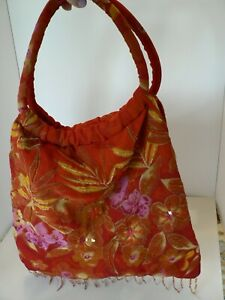 RED FLORAL SEQUIN CARRY PURSE, USED