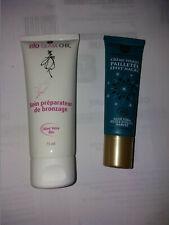 Lot de 2 cosmétiques BIO (soin préparateur bronzage et crème visage pailleté)