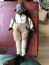 Antique African American Whistler Composition Doll. 14 Inches tall.
