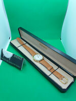 ladies accurist gold tone watch,white face,brown tan leather strap,in its box.