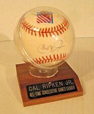 Autographed Cal Ripken JR Baseball on wooden base