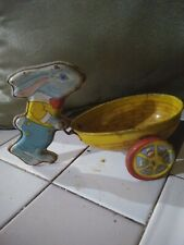 Vintage J.Chein litho Tin toy Bunny pushing easter cart.