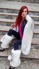 Saga Blue fox leg warmers.With pompons