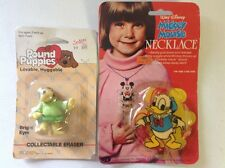 SEALED 1986 Pound Puppies eraser and 1980's Donald Duck necklace toys