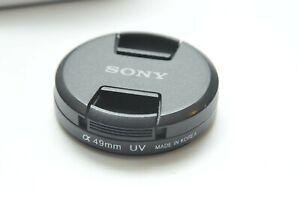 Genuine Sony OEM 49mm Snap-On Lens Cap + a series UV Filter