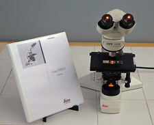 LEICA DMLS BINOCULAR RESEARCH MICROSCOPE W/3 LEICA INFINITY OBJECTIVES + MANUAL