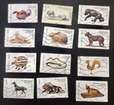 """carnet """"Les Animaux Dans L'art"""" composé de 12 timbres oblitérés 2013"""