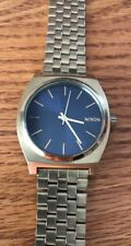 Men's Nixon Minimal The Time Teller Gold Tone Blue Dial Stainless Steel Watch.