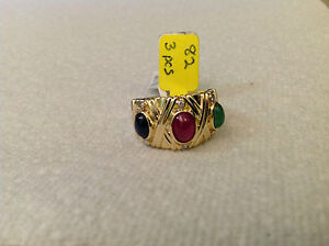 14k yellow gold  cabochon style ring,diamond,rubie, sapphire,emerald