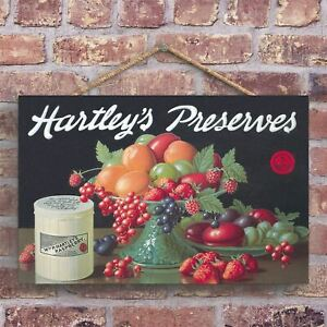 A CLASSIC HARTLEY'S PRESERVES VINTAGE AD ON A WOODEN PLAQUE