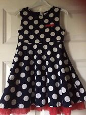 E-Vie angel,navy with white spots,red netting showing under dress,age 2.M/wash