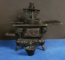 Vintage Crescent Cast Iron Mini Toy Stove With Accessories.  Made in the USA.