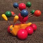 Vintage Multi-Color Wood Caterpillar Toy On Wheels - Top Spins As Feet Roll
