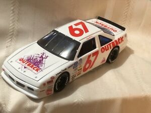 NASCAR Diecast 1/24 Scale #67 Jeff Gordon Outback Steakhouse 1990 Pontiac Bank
