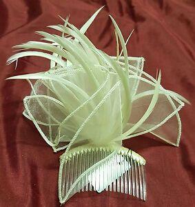 Cream mesh fabric hair comb accented with elegant cream feathers.