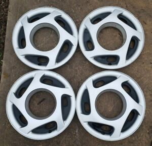 Set of 4 OEM 1994-1996 Dodge Stealth Polycast Wheel Covers for 15x6 Steel Wheels