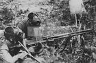 WW2 photo Chinese soldiers dressed in gas masks with a ZB machine gun. vz.  #453