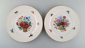 KPM, Berlin. Two antique porcelain plates with hand-painted flower baskets.