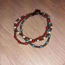 Brass And Bead Triple Bracelet With Rattle Clasp, red, blue & brown beads