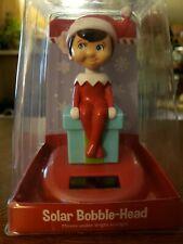 The Elf on the Shelf Solar bobblehead E2