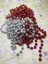 2 strings of festive red and silver beads