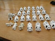 Collections of toy dalmation dogs as dominoes plus other dogs