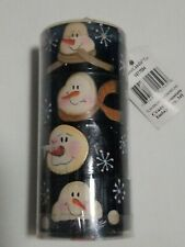 Set of four yankee candle ceramic snowman votive holders four different faces.