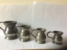 ANTIQUE BALUSTER PEWTER MEASURES X 4.