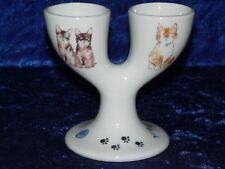 Cats design double egg cups. Porcelain eggcup designed for 2 boiled eggs