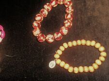 2 X UNUSUAL ELASTICATED WOODEN BEAD BRACELETS 1 = PAINTED 1 = CRUCIFIX & JESUS