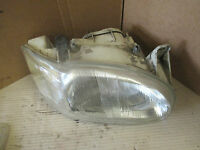 FORD ESCORT 1997 DRIVER SIDE ELECTRIC HEADLIGHT O/S/F