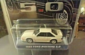 1/64 GREENLIGHT 25 YEARS 1989 FORD MUSTANG GT 5.0 HATCHBACK fox WHITE