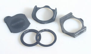2 COKIN ADAPTER RING HOLDERS WITH 49MM AND 52MM ADAPTER RINGS AND COVER 5 PIECES