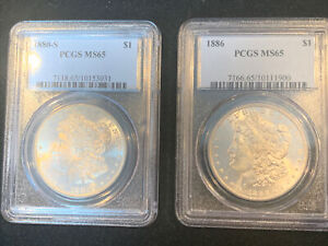 2 PCLOT 1880-S MS656 AND 1886-P MS65 MORGAN DOLLARS IN BLUE PCGS HOLDERS