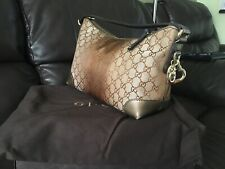 Gucci gold logo handbag