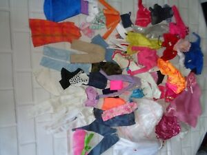 Barbie mixed bundle of dolls clothes and other dolls clothes( accessories )