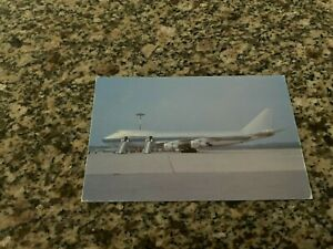 Dominicana Airlines Boeing 747 parked at airport with boarding stairs postcard
