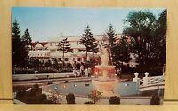 W21) Postcard Playing Shuffleboard MOUNT AIRY LODGE Pocono PA fountain garden