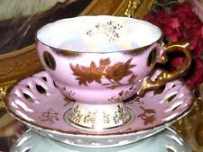 PINK IRIDESCENT ETCHED GOLD PIERCED FOOTED TEA CUP AND SAUCER JAPAN