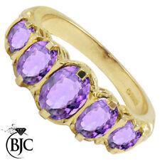 Anelli di lusso con gemme viola in oro giallo anniversario