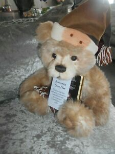 charlie bear anniversary santa paws wears a hat and scarf labels tags on