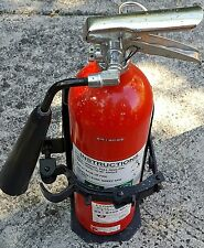 Carbon Dioxide Fire Extinguisher and Secure Vehicle Mounting Bracket.