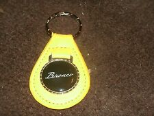 1960's 1970's FORD BRONCO SCRIPT LOGO VINTAGE LEATHER KEYCHAIN KEYRING NEW YELLO