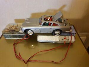Giocattolo antico Tin Toy car Aston Martin secret ejector car DAIYA  Japan