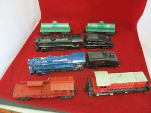 Vintage Marx Train Items: 2 #666 Locos, 2 Tank Cars, 1 Caboose, 1 #1998 Switcher