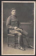 A seated Soldier in uniform  - Vintage WWI First World War Postcard
